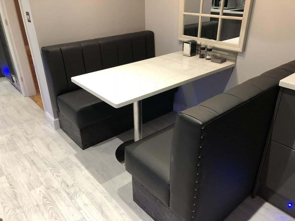 Black faux leather booth seat